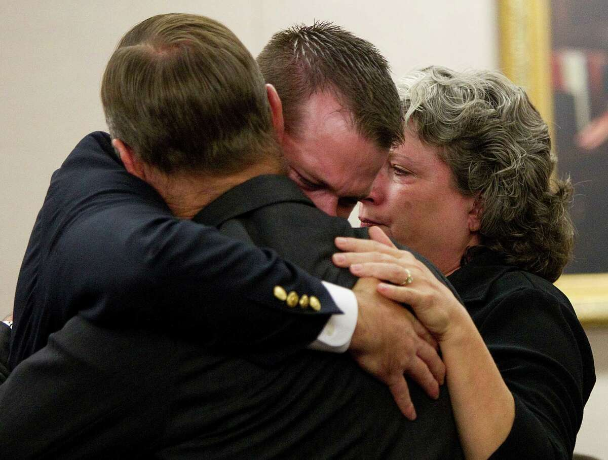 Former HPD officer Andrew Blomberg embraces his parents after being found not guilty in a Harris County court Wednesday.