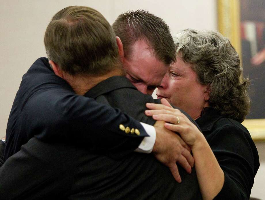 Former HPD officer Andrew Blomberg embraces his parents after being found not guilty in a Harris County court Wednesday. Photo: Brett Coomer / © 2012 Houston Chronicle