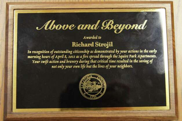 Plaque presented to former Army Sgt. Richard Strojil of Clifton Park for alerting and rescuing neighbors when a fire struck his apartment complex. (Christine Sansom)