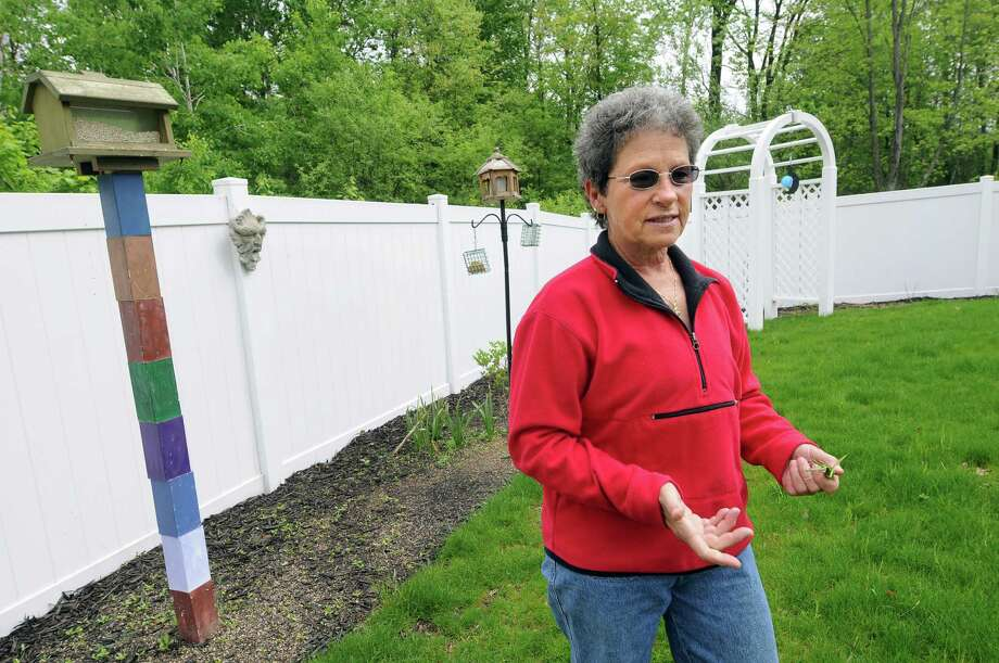 Celeste Sodano talks about the shoddy fence job on Wednesday, May 16, 2012, at her home in Niskayuna, N.Y. (Cindy Schultz / Times Union) Photo: Cindy Schultz / 00017713A