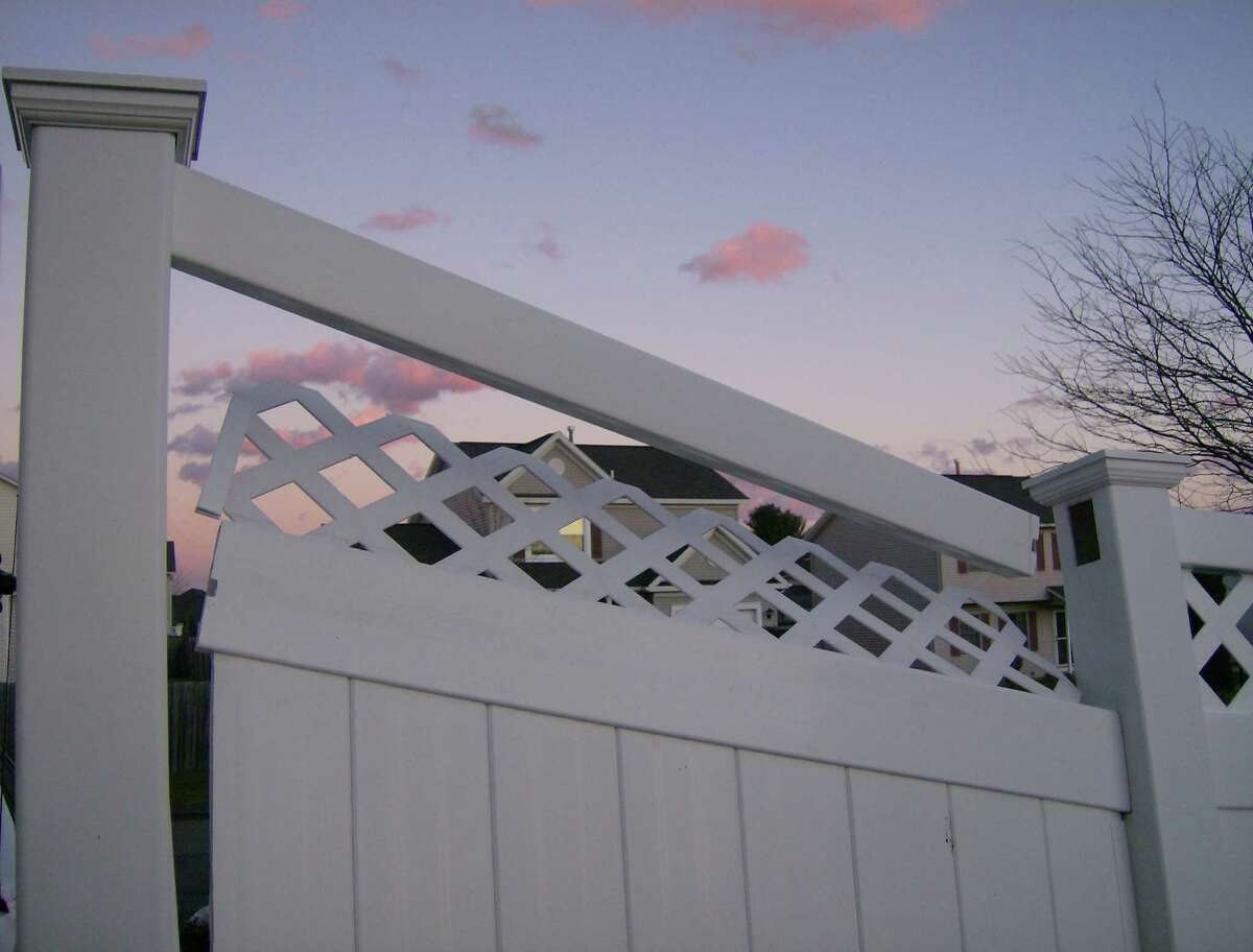 John and Pat Tibbitts, who live in Latham, say they hired James Messmore, owner of Affordable Fence, to construct a backyard fence in 2006. But the fence quickly deteriorated, they said, and came apart. (Photo submitted by John Tibbitts)