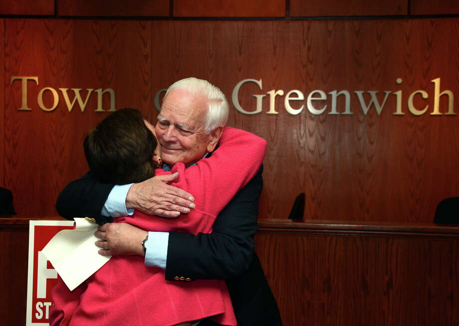Lloyd Hull, of Greenwich, hugs Livvy Floren, R-149th District, after nominating her for another term in office during a meeting at Greenwich Town Hall on Wednesday, May 16, 2012. Photo: Amy Mortensen / Connecticut Post Freelance