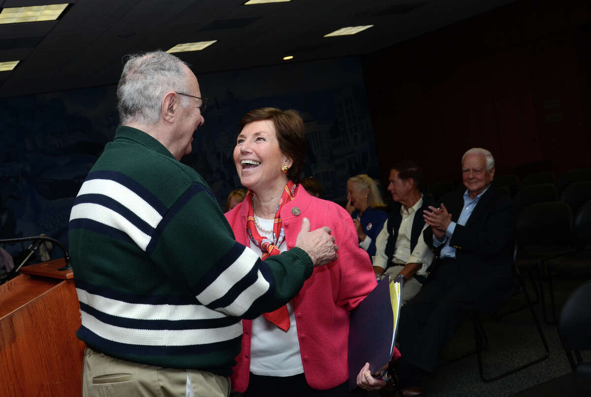 Michael Pansini, of Stamford, congratules Livvy Floren, R-149th District, after seconding her nomination for another term in office during a meeting at Greenwich Town Hall on Wednesday, May 16, 2012.