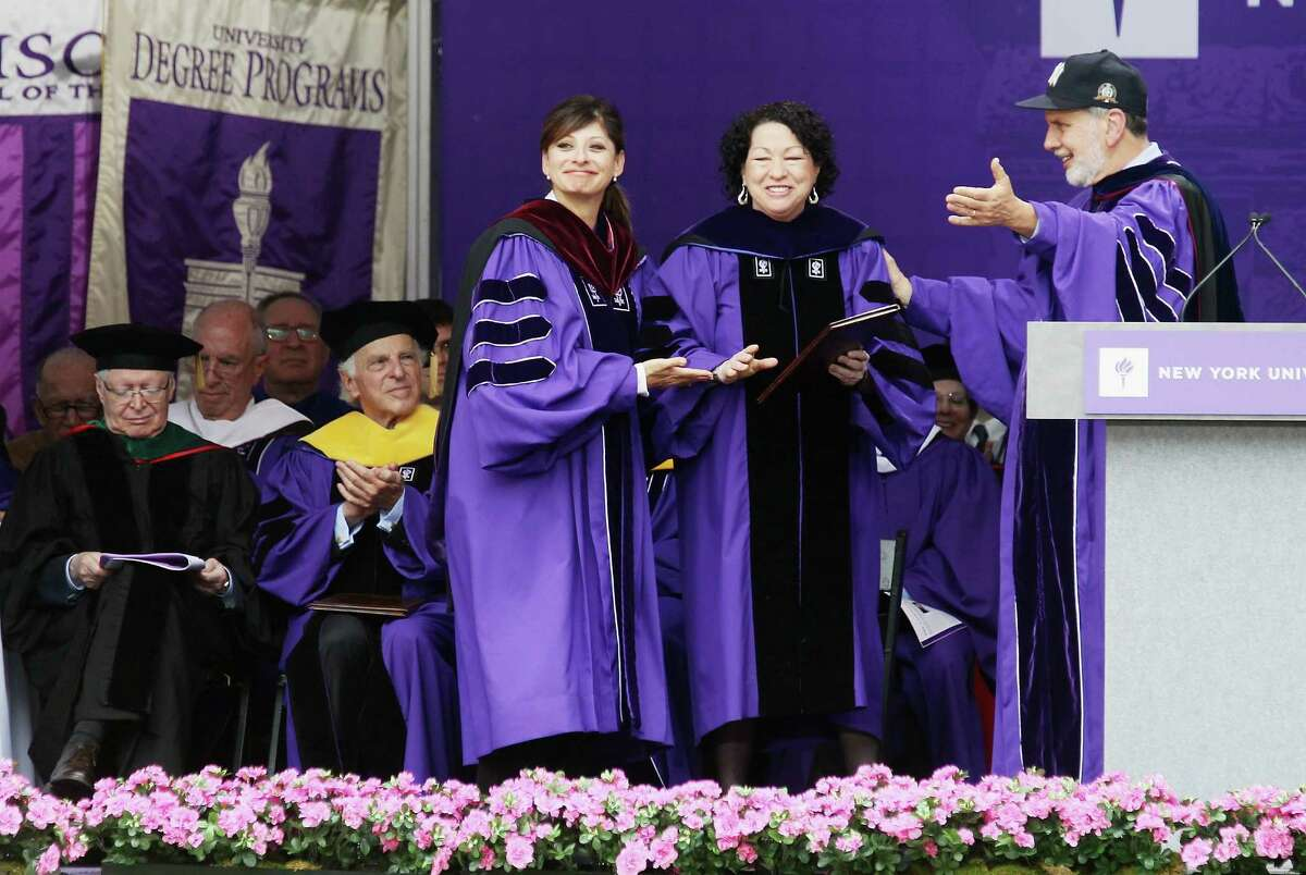 NEW YORK, NY - MAY 16: U.S. Supreme Court Justice Sonia Sotomayor (2nd R), NYU President John Sexton (R) and TV financial journalist Maria Bartiromo (C) attend New York University's commencement ceremony at Yankee Stadium on May 16, 2012 in the Bronx borough of New York City. Sotomayor spoke to a crowd of more than 27,000 at the ceremony and was raised in a Bronx housing project not far from the stadium. (Photo by Mario Tama/Getty Images)