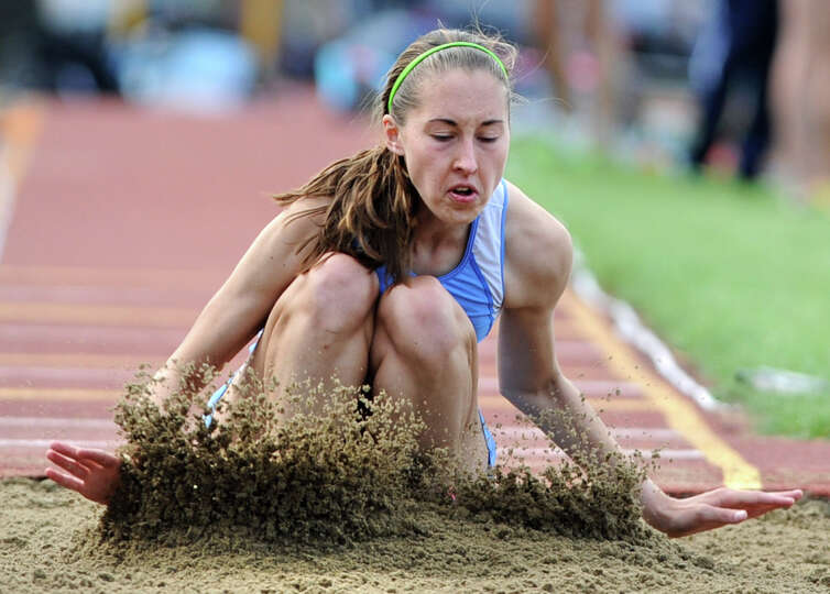 Shaker senior Emma Torncello, 18, competes in the long jump during the Suburban Council girls track