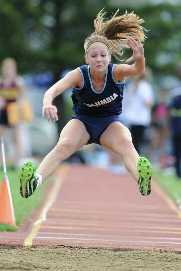 Columbia junior Eva Kiehl, 17, competes in the long jump during the Suburban Council girls track mee