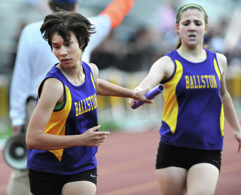Ballston Spa sophomore Hope Danison gets the baton passed to her by her freshman teammate Caitlyn Gardiner during a 4x8 relay race at the Suburban Council girls track meet Wednesday, May 16, 2012 Colonie, N.Y.  (Lori Van Buren / Times Union) Photo: Lori Van Buren