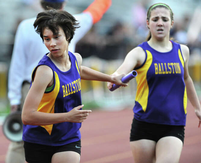 Ballston Spa sophomore Hope Danison gets the baton passed to her by her freshman teammate Caitlyn Ga