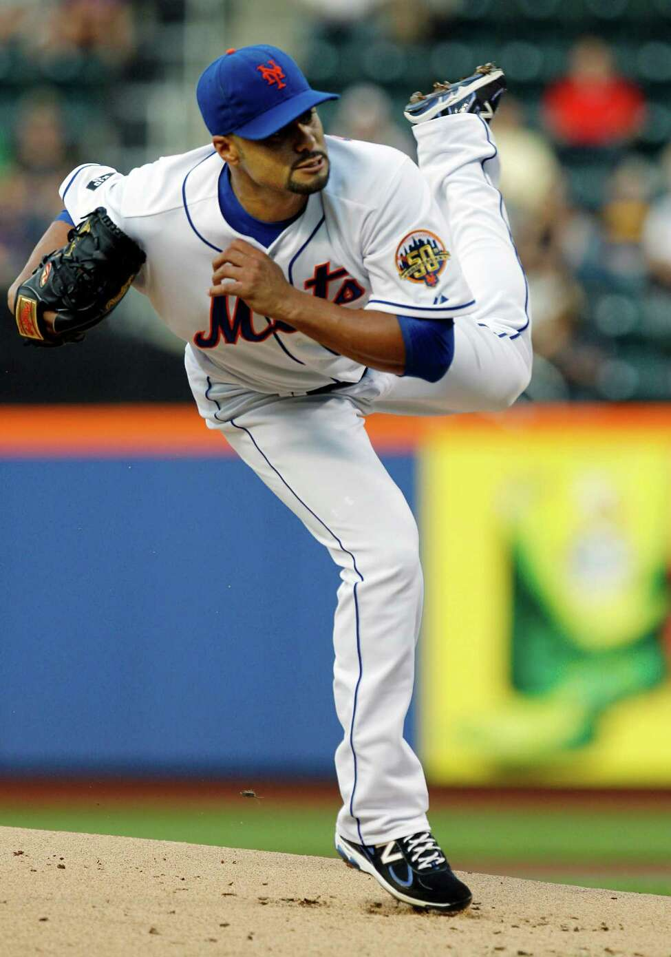 New York Mets starting pitcher Johan Santana (57) delivers against the Cincinnati Reds in the first inning of their baseball game at Citi Field in New York, Wednesday, May 16, 2012. (AP Photo/Kathy Willens)