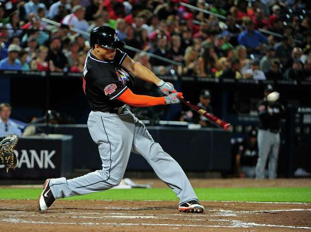 ATLANTA, GA - MAY 16: Giancarlo Stanton #27 of the Miami Marlins hits a seventh inning home run against the Atlanta Braves at Turner Field on May 16, 2012 in Atlanta, Georgia. Photo: Scott Cunningham, Getty Images / 2012 Getty Images