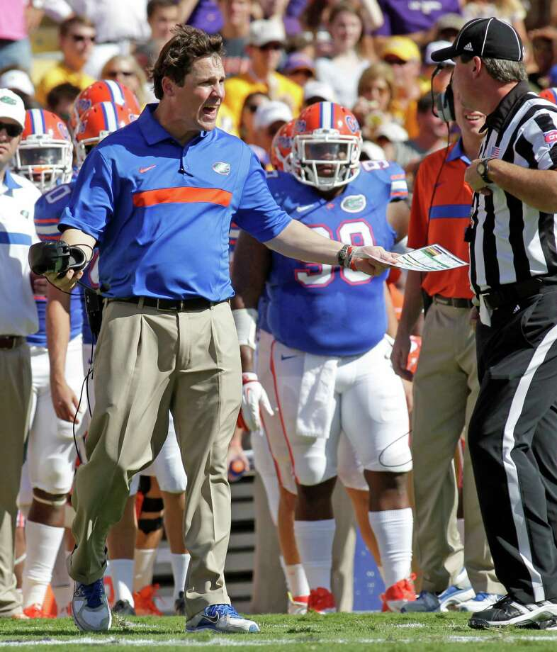 Florida coach Will Muschamp talks with the official in the first half of an NCAA college football game against LSU in Baton Rouge, La., Saturday, Oct.  8, 2011. (AP Photo/Bill Haber) Photo: Bill Haber / FR170136 AP