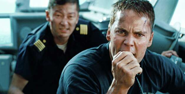 "Tadanobu Asano (left) and Taylor Kitsch are shown in a scene from ""Battleship."" Photo: UNIVERSAL PICTURES"