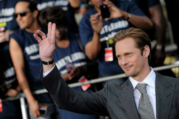 "Alexander Skarsgard, a cast member in the film ""Battleship,"" waves at the American premiere of the film, Thursday, May 10, 2012, in Los Angeles. The film is released in theaters this Friday, May 18. Photo: Chris Pizzello, Associated Press"