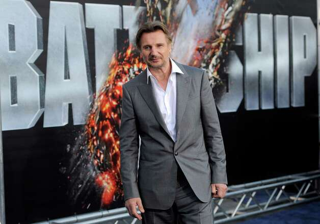 "Liam Neeson, a cast member in the film ""Battleship,"" poses at the American premiere of the film, Thursday, May 10, 2012, in Los Angeles. The film is released in theaters this Friday, May 18. Photo: Chris Pizzello, Associated Press"