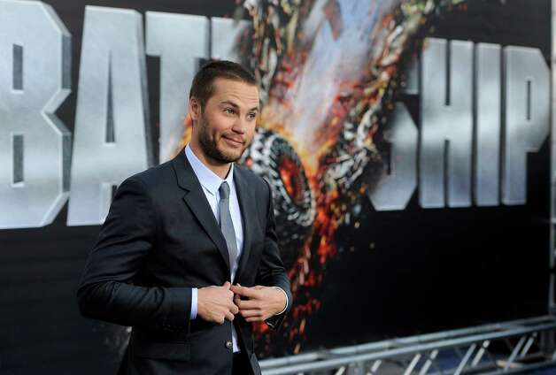 "Taylor Kitsch, a cast member in ""Battleship,"" poses at the American premiere of the film, Thursday, May 10, 2012, in Los Angeles. The film is released in theaters this Friday, May 18. Photo: Chris Pizzello, Associated Press"