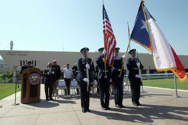A Color Guard stands at attention as ceremonies begin on May 16, 2012, at the Institute of Texan Cultures celebrating the near completion of the Faces with Names photo project. The project is an effort to locate photos and profiles of San Antonio and Bexar County area soldiers that were killed in the Vietnam War. Photo: John Davenport