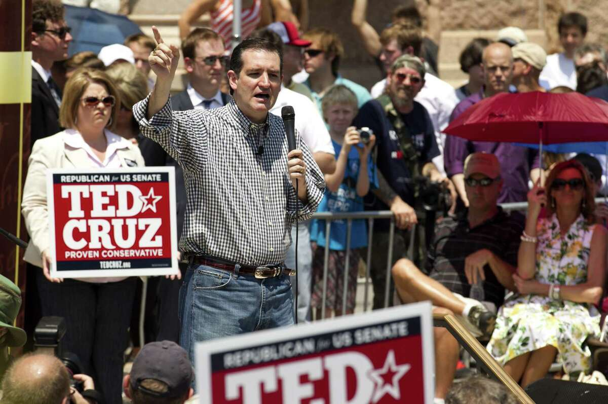 U.S. Senate candidate Ted Cruz greets supporters at The Tea Party Express rally at the Capitol in Austin, Texas, on Sunday May 6, 2012. Thousands attended the event, which included speeches by Paul and U.S. Senate candidate Ted Cruz. (AP Photo/Austin American-Statesman, Jay Janner) MAGS OUT; NO SALES; INTERNET AND TV MUST CREDIT PHOTOGRAPHER AND STATESMAN.COM