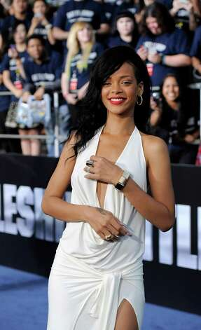 "Rihanna, a cast member in ""Battleship,"" poses at the American premiere of the film, Thursday, May 10, 2012, in Los Angeles. The film is released in theaters this Friday, May 18. Photo: Chris Pizzello, Associated Press"