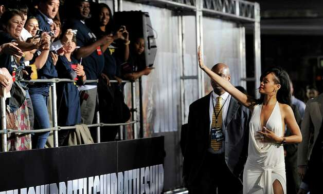 "Rihanna (right) a cast member in ""Battleship,"" waves to fans at the American premiere of the film, Thursday, May 10, 2012, in Los Angeles. The film is released in theaters this Friday, May 18. Photo: Chris Pizzello, Associated Press"