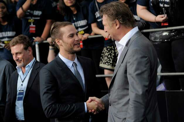 "Taylor Kitsch (left), a cast member in the film ""Battleship,"" greets fellow cast member Liam Neeson on the carpet at the American premiere of the film, Thursday, May 10, 2012, in Los Angeles. The film is released in theaters this Friday, May 18. Photo: Chris Pizzello, Associated Press"