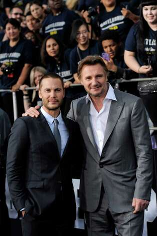 "Taylor Kitsch (left) and Liam Neeson, cast members in the film ""Battleship,"" pose together at the premiere of the film, Thursday, May 10, 2012, in Los Angeles. The film is released in theaters this Friday, May 18. Photo: Chris Pizzello, Associated Press"
