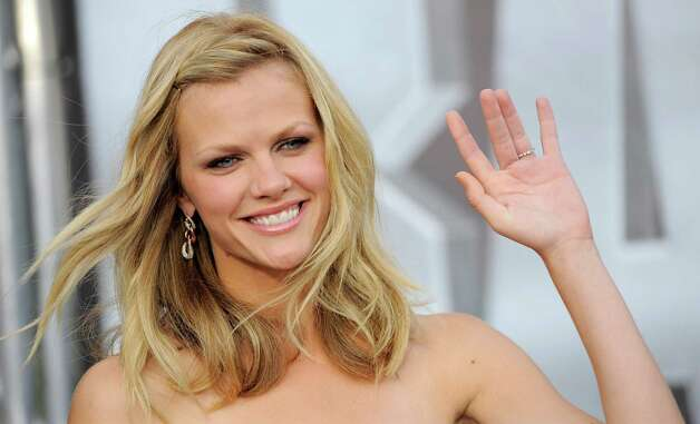 "Brooklyn Decker, a cast member in the film ""Battleship,"" waves to photographers at the American premiere of the film, Thursday, May 10, 2012, in Los Angeles. The film is released in theaters this Friday, May 18. Photo: Chris Pizzello, Associated Press"