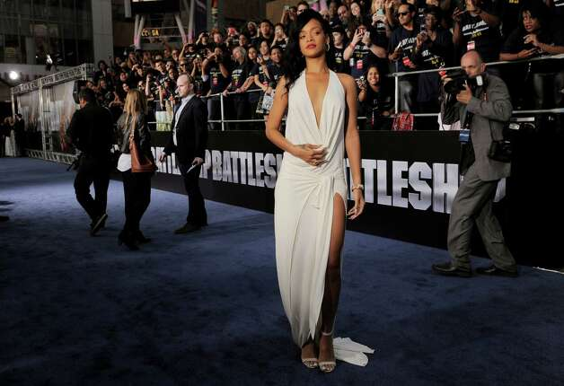 "Rihanna, a cast member in ""Battleship,"" poses on the carpet at the American premiere of the film, Thursday, May 10, 2012, in Los Angeles. The film is released in theaters this Friday, May 18. Photo: Chris Pizzello, Associated Press"