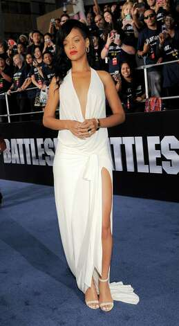 "Rihanna, a cast member in the film ""Battleship,"" poses at the American premiere of the film, Thursday, May 10, 2012, in Los Angeles. The film is released in theaters this Friday, May 18. Photo: Chris Pizzello, Associated Press"