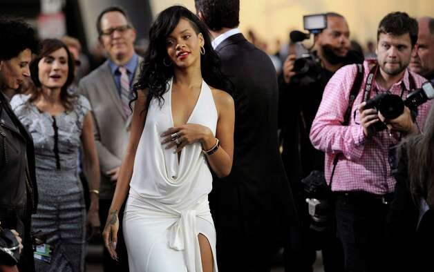 "Rihanna, a cast member in the film ""Battleship,"" arrives at the American premiere of the film, Thursday, May 10, 2012, in Los Angeles. The film is released in theaters this Friday, May 18. Photo: Chris Pizzello, Associated Press"