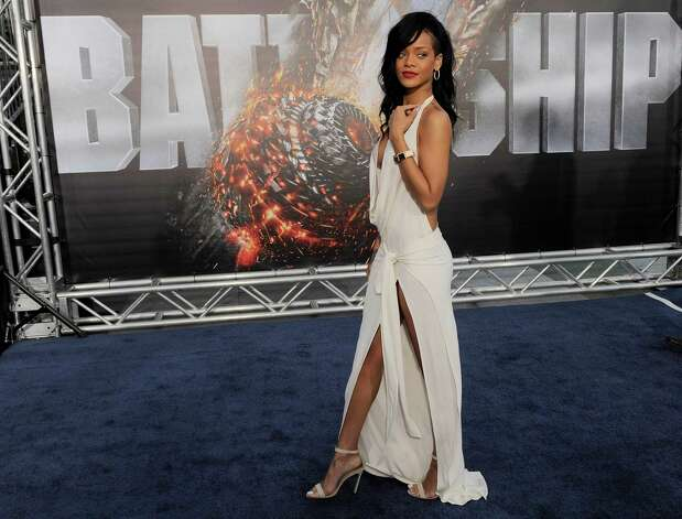 "Rihanna, a cast member in the film ""Battleship,"" walks the carpet at the American premiere of the film, Thursday, May 10, 2012, in Los Angeles. The film is released in theaters this Friday, May 18. Photo: Chris Pizzello, Associated Press"