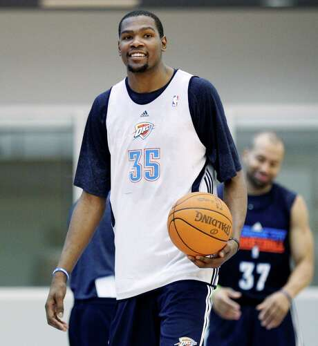 Oklahoma City Thunder's Kevin Durant smiles as he walks off the court following NBA basketball practice in Oklahoma City, Friday, May 11, 2012. The Thunder will have had eight full days off when they start the Western Conference semifinals on Monday night against either the Denver Nuggets or the Los Angeles Lakers. (AP Photo/Sue Ogrocki) Photo: Sue Ogrocki, STF / AP