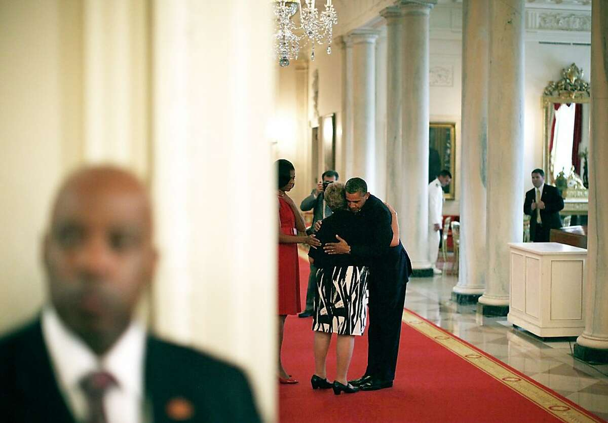 WASHINGTON, DC - MAY 16: U.S. President Barack Obama (R) hugs Rose Mary Sabo-Brown (2nd R), widow of Army Specialist Leslie H. Sabo, Jr., as first lady Michelle Obama (3rd R) looks on after a Medal of Honor presentation ceremony May 16, 2012 at the White House in Washington, DC. Specialist Sabo was presented with the highest military decoration posthumously for his heroic actions on May 10, 1970 while serving as a rifleman in Cambodia during the Vietnam War. (Photo by Alex Wong/Getty Images)