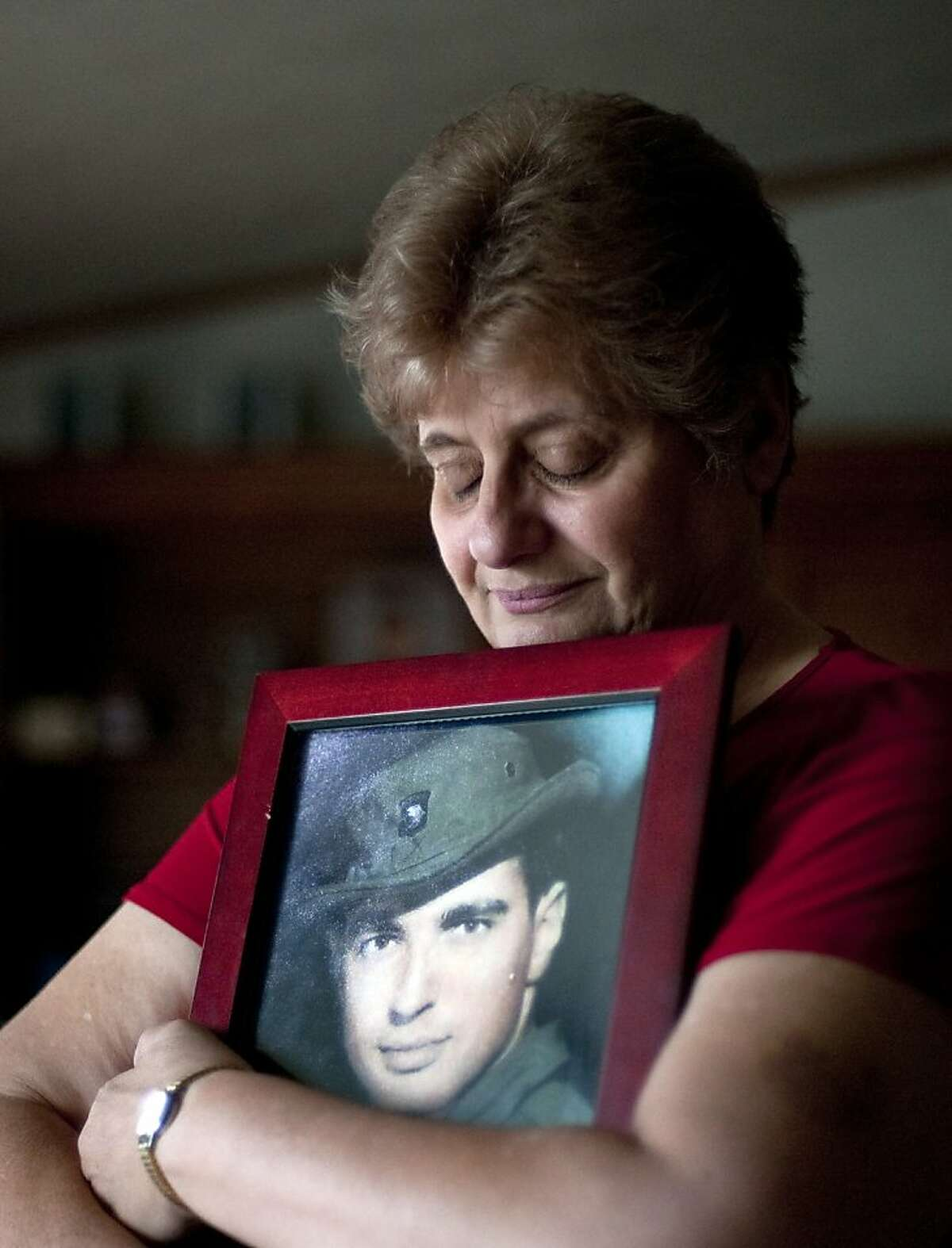 FILE -- In a May 10, 2012 file photo Rose Mary Sabo-Brown holds a photo of her husband Army Specialist Leslie H. Sabo, Jr., in her home in New Castle, Pa. Sabo was killed in 1970 in Cambodia during the Vietnam War and is to posthumously receive the Medal of Honor in a ceremony at the White House Wednesday May 16, 2010. (AP Photo/Andrew Russell, Tribune-Review, file)