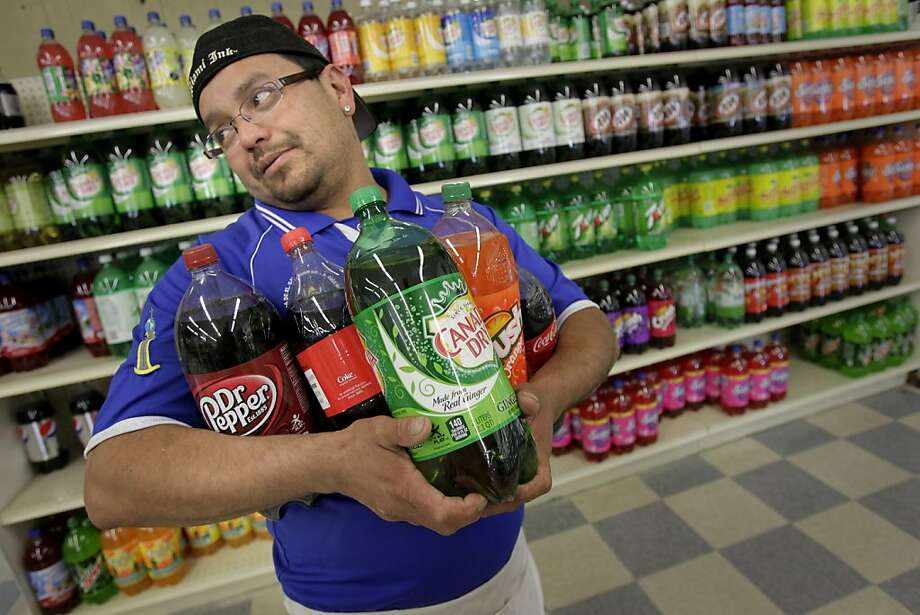 Juan Cerritos, who drinks and sells soda, opposes the Richmond City Council's move to tax them. Photo: Brant Ward, The Chronicle