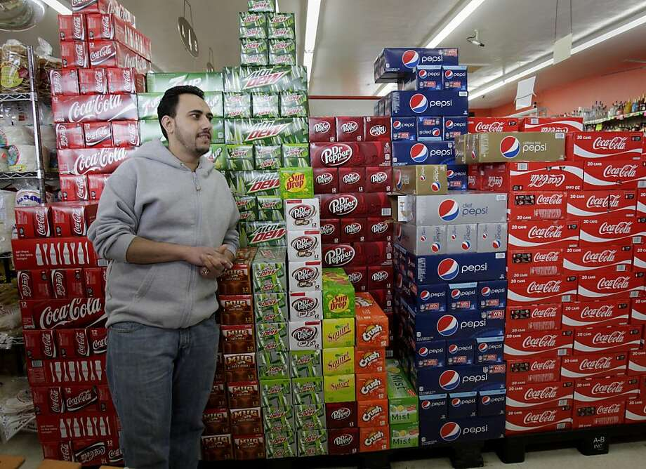 Omar Nassar, manager of the Richmond Food Center, stands in front of a mountain of soda varieties. He figures he will lose some business if the soda tax passes and people will go out of Richmond for their soda purchases. The Richmond City Council has approved a measure for the November ballot which would ask voters to approve a tax on soda and sugary drinks, the first such tax in the nation. Photo: Brant Ward, The Chronicle