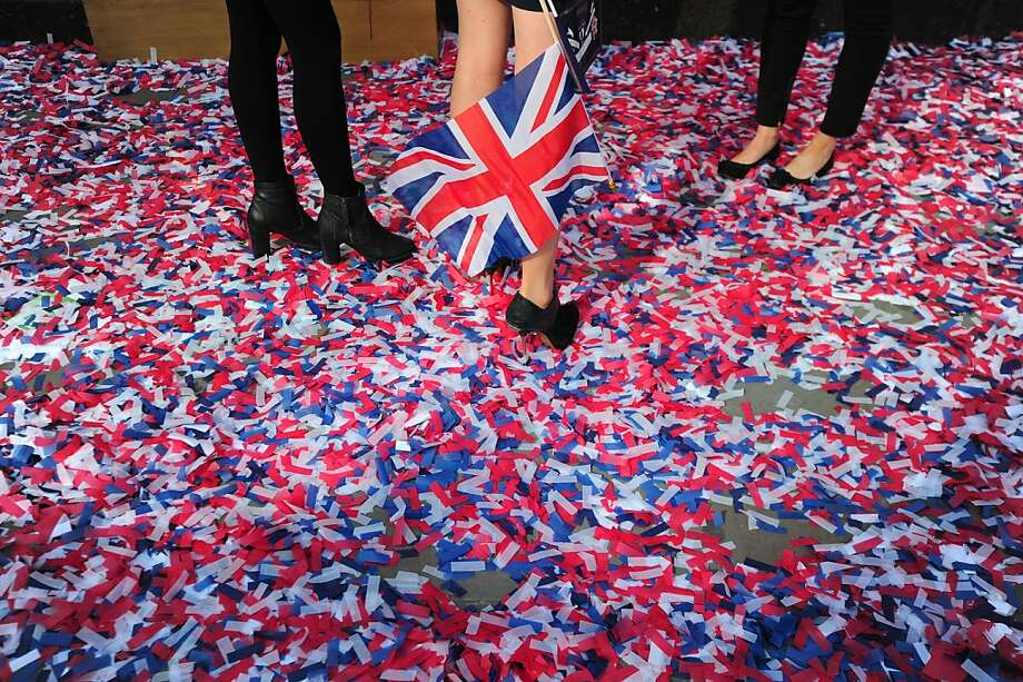 TOPSHOTS  Confetti is pictured on the ground outside Harrods department store in London, on May 16, 2012, as employees of the store celebrate Queen Elizabeth II's forthcoming Diamond Jubilee. The Queen's Diamond Jubilee will take place June 2-5, 2012, and celebrations will include a festival of boats on the river Thames and the lighting of more than 2,000 beacons around the country during a four-day public holiday. AFP PHOTO/CARL COURTCARL COURT/AFP/GettyImages Photo: Carl Court, AFP/Getty Images