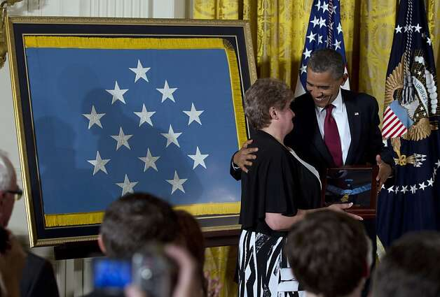 President Barack Obama awards posthumously the Medal of Honor to Rose Mary Sabo-Brown, widow of Specialist Leslie H. Sabo, Jr., US Army, during a ceremony in the East Room of the White House in Washington, Wednesday, May 16, 2012. Sabo was killed in 1970 in Cambodia during the Vietnam War. Also on stage is Sabo's brother George Sabo. (AP Photo/Carolyn Kaster) Photo: Carolyn Kaster, Associated Press