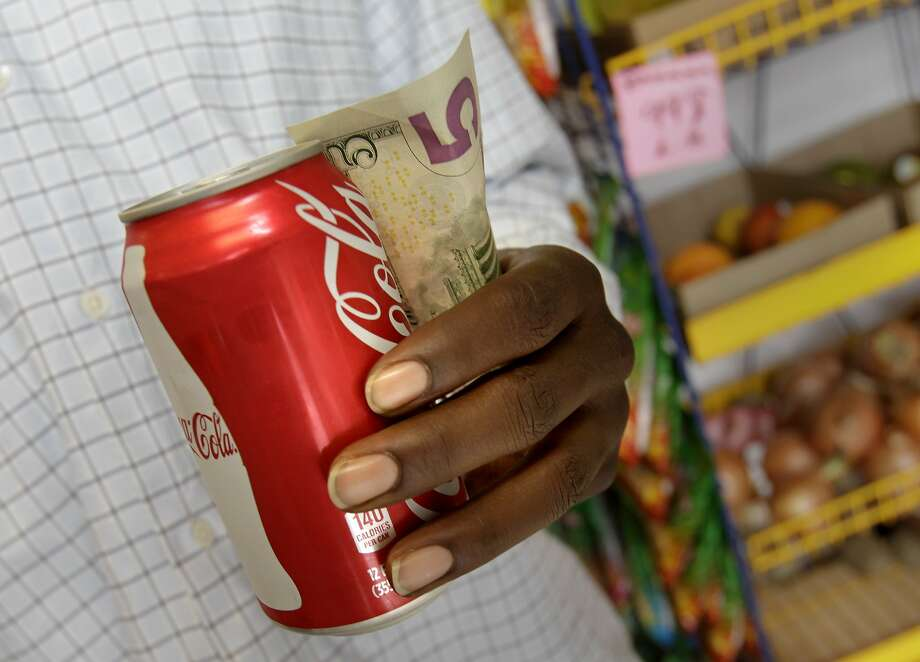 If the measure passes, Richmond, Calif. shoppers will pay more for their sodas. The Richmond City Council has approved a measure for the November ballot which would ask voters to approve a tax on soda and sugary drinks, the first such tax in the nation. Photo: Brant Ward, The Chronicle
