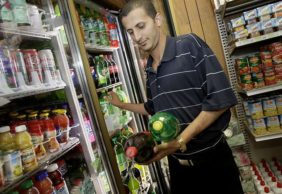 Noman Alwahainy stocks soda at his market in Richmond, where voters last year defeated a soda-tax measure that had heavily funded opposition. Photo: Brant Ward, The Chronicle