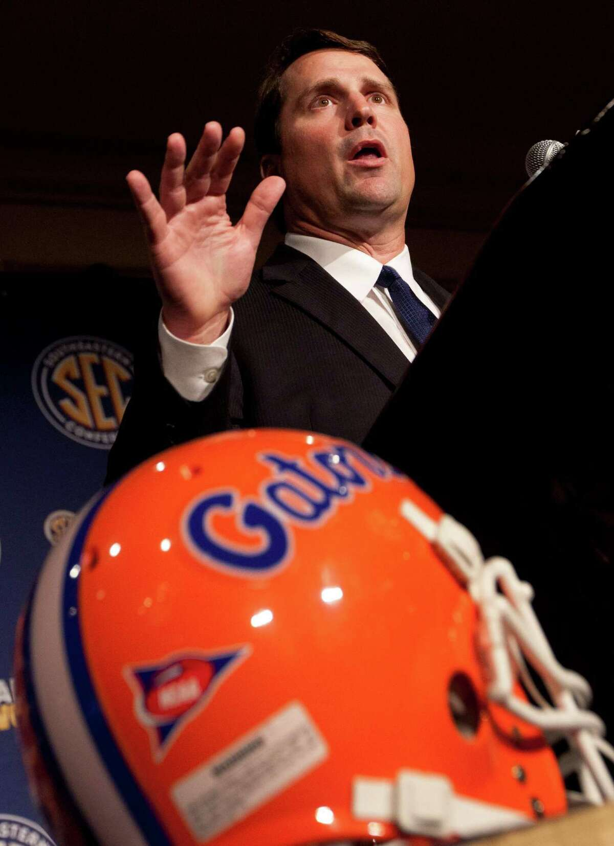 Florida coach Will Muschamp talks with reporters during Southeastern Conference Football Media Days in Birmingham, Ala., Wednesday, July 20, 2011.
