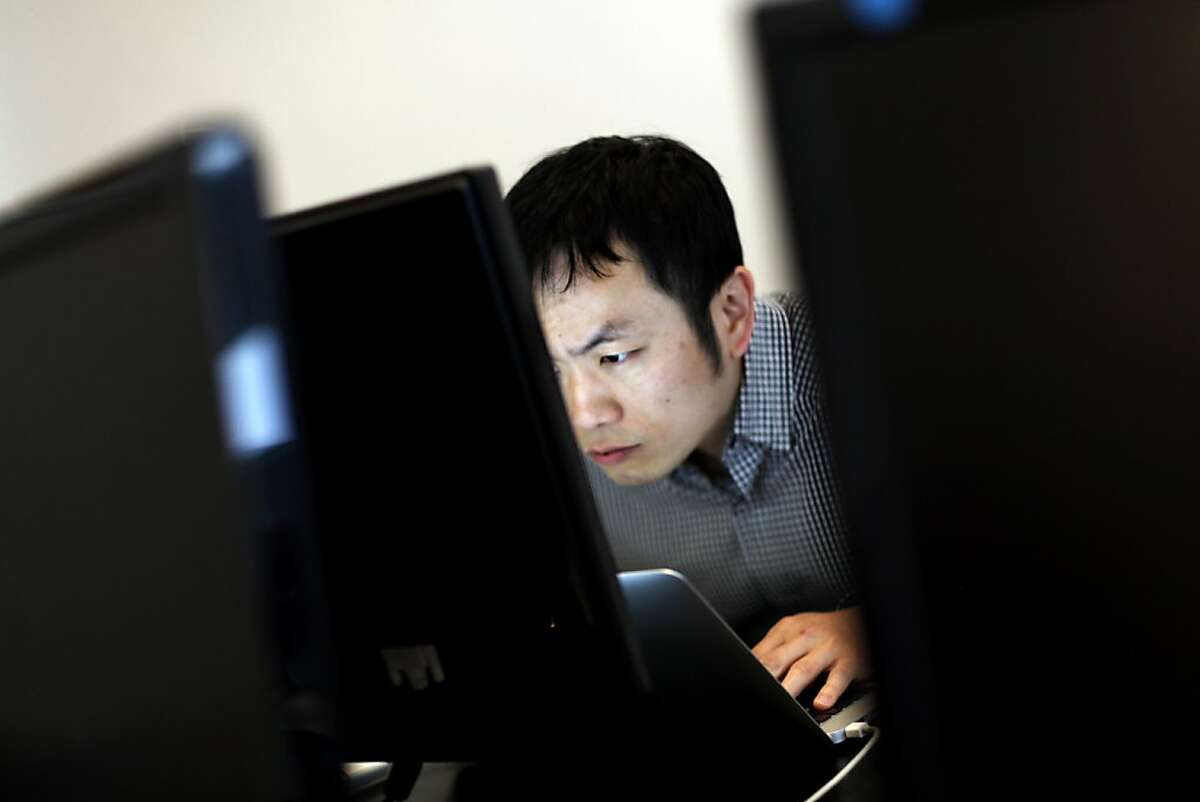 Fang-Yu Lin works on his computer at the Crowdtilt offices in San Francisco, Calif., Friday, May 4, 2012.