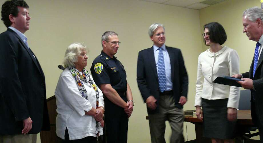 """First Selectman Michael Tetreau, far right, presents certiticate of appreciation to American Red Cross """"Community Hero"""" honorees, from left, Bryan Cafferelli, Paige Herman, and police Capt. Josh Zabin (accepting for Officer Scott Sudora). Also pictured are Selectmen James Walsh and Cristin McCarthy Vahey. Other honorees Eric Barthel, Sudora, and Bob Trez could not attend. Photo: Genevieve Reilly / Fairfield Citizen"""