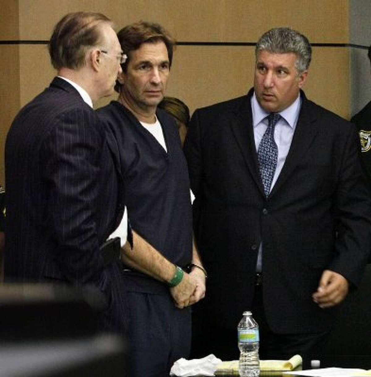 John Goodman, center, talks with his attorneys Roy Black and Guy Fronstin during his sentencing hearing on May 11 in West Palm Beach, Fla. (AP Photo/The Palm Beach Post, Lannis Waters, Pool) (Lannis Waters / Associated Press)