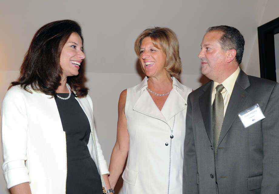 From left, Giovanna Miller and Terry Lamantia Cataldo, both of Greenwich, speak with Greenwich United Way President Stuart Adelberg, during a meeting at the Milbrook Club in Greenwich, Thursday night, May 3, 2012. Photo: Bob Luckey / Greenwich Time
