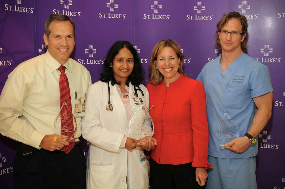 "Seshasree Marupudi (center left) was chosen 2012 Physician of the Year"" at St. Luke's The Woodlands Hospital."