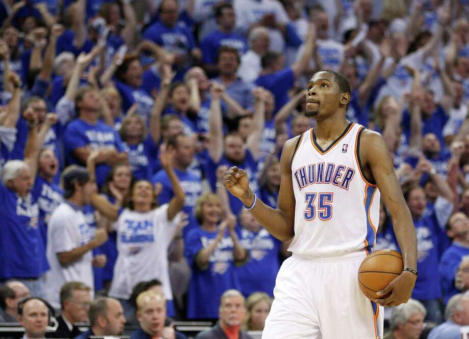 Oklahoma City Thunder forward Kevin Durant pumps his fist late in the fourth quarter in Game 2 of an NBA basketball playoffs Western Conference semifinal, in Oklahoma City on Wednesday, May 16, 2012. Oklahoma City won 77-75. (AP Photo/Sue Ogrocki) Photo: Sue Ogrocki, Associated Press / AP