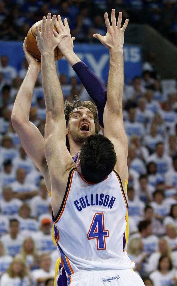 Los Angeles Lakers forward Pau Gasol, rear, shoots as Oklahoma City Thunder center Nick Collison (4) defends during the second quarter in Game 2 of an NBA basketball playoffs Western Conference semifinal, in Oklahoma City on Wednesday, May 16, 2012. (AP Photo/Sue Ogrocki) Photo: Sue Ogrocki, Associated Press / AP