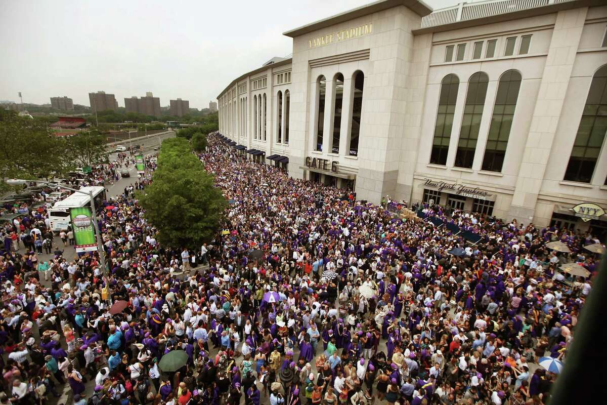 NEW YORK, NY - MAY 16: Crowds depart after New York University's commencement ceremony at Yankee Stadium on May 16, 2012 in the Bronx borough of New York City. U.S. Supreme Court Justice Sonia Sotomayor spoke to a crowd of more than 27,000 at the ceremony and was raised in a Bronx housing project not far from the stadium.