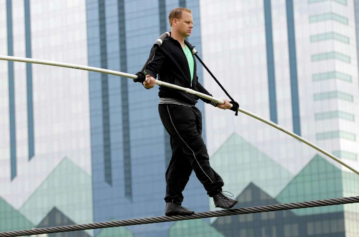 Nik Wallenda performs a walk on a tightrope during training for his walk over Niagara Falls in Niagara Falls, N.Y., Wednesday, May 16, 2012.