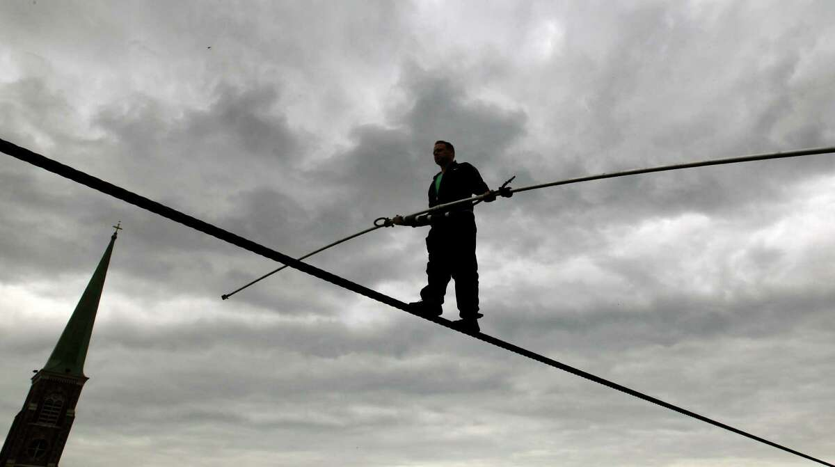 Nik Wallenda performs a walk on a tightrope in the rain during training for his walk over Niagara Falls in Niagara Falls, N.Y., Wednesday, May 16, 2012.